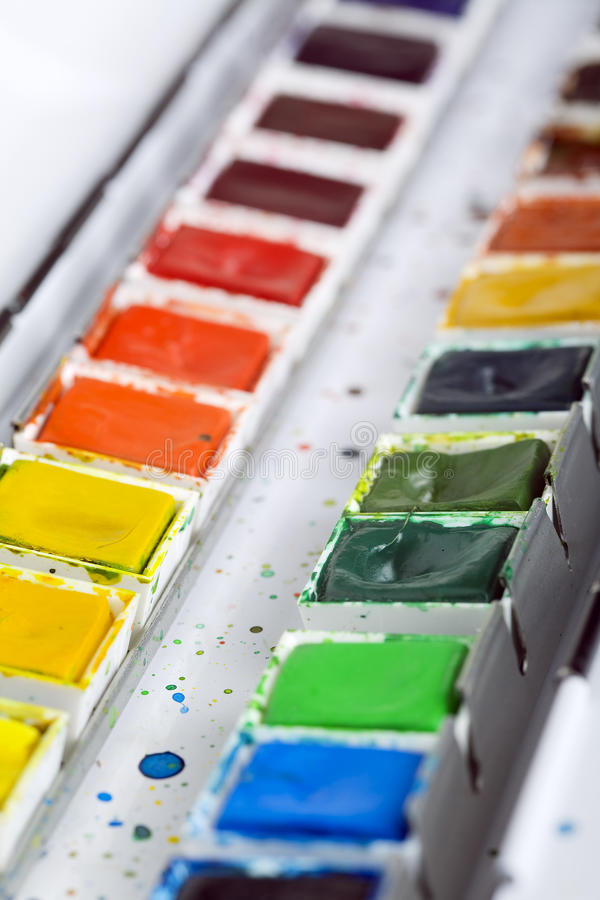 Artistic aquarell paints. Close up of artistic aquarell paints in a metal box royalty free stock photo