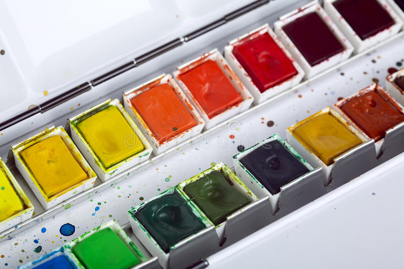 Artistic aquarell paints. Close up of artistic aquarell paints in a metal box stock image
