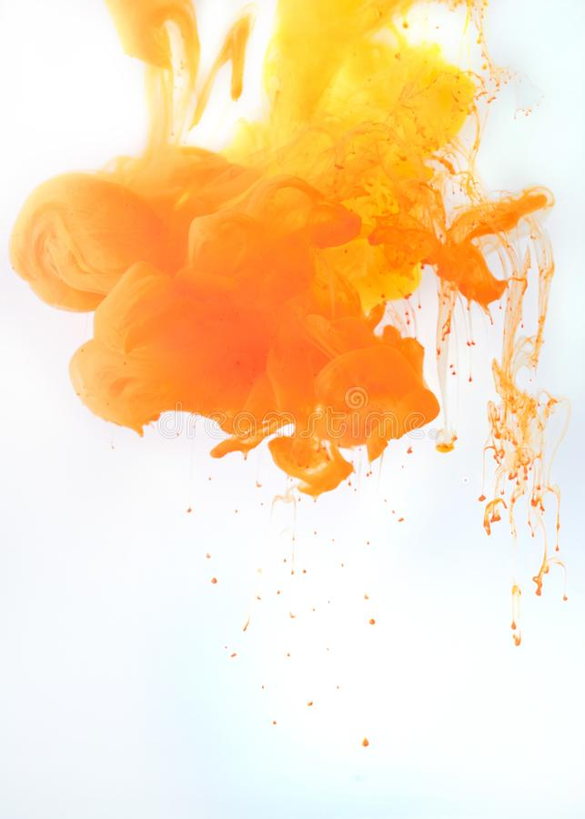 artistic background with flowing orange paint, isolated on white royalty free stock photo