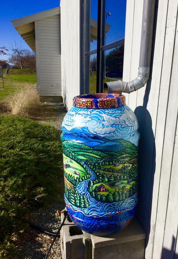 Artistic barrel. In a rest area in Williston in Vermont, artistic barrel to catch rain water for plants, an ecologic cycle stock photos