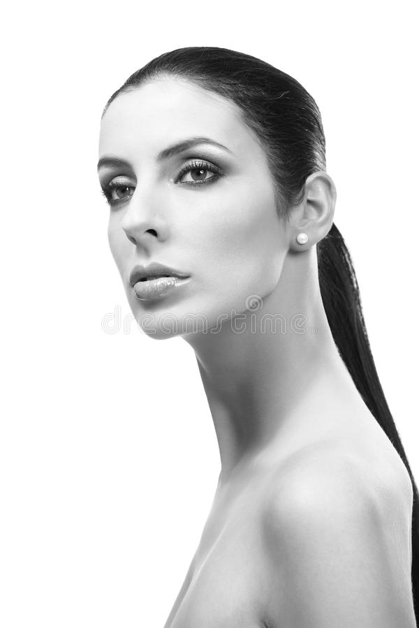 Artistic black and white portrait of young woman. Artistic black and white portrait of attractive young woman with bare shoulders royalty free stock photography