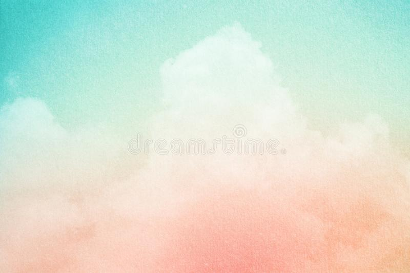 Artistic cloudy sky with pastel gradient color and grunge paper texture, nature background stock photo