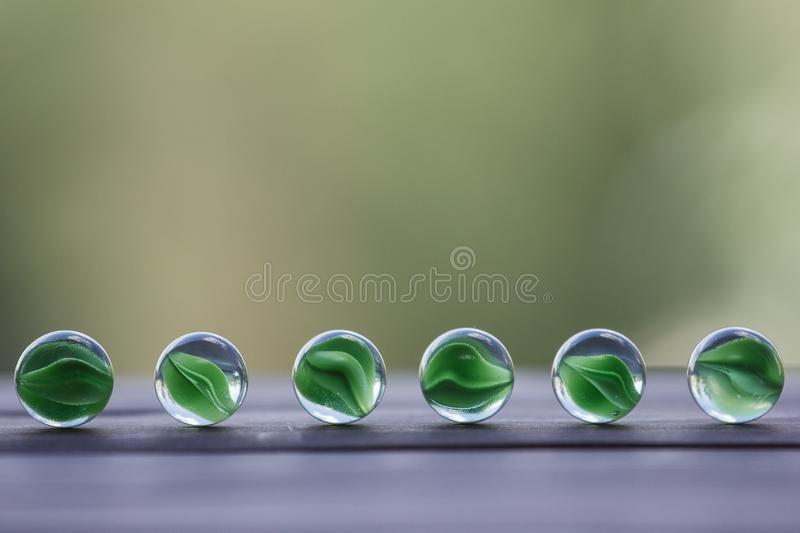 Artistic composition of marbles clear glass balls. Art composition of transparent glass balls. Marbles. Children`s games. Marble. Glass marbles decoration color stock images