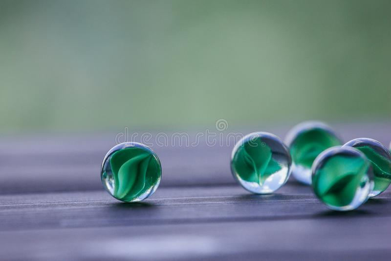 Artistic composition of marbles clear glass balls. Art composition of transparent glass balls. Marbles. Children`s games. Marble. Glass marbles decoration color stock photography