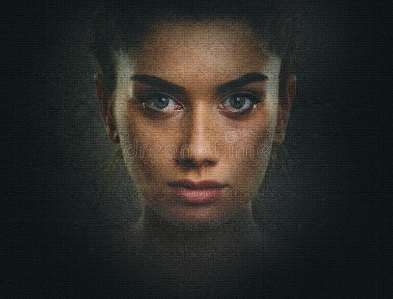Artistic dark portrait of young woman with beautiful face and eyes stock photo