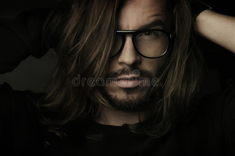 Artistic dark portrait of the young beautiful man stock image
