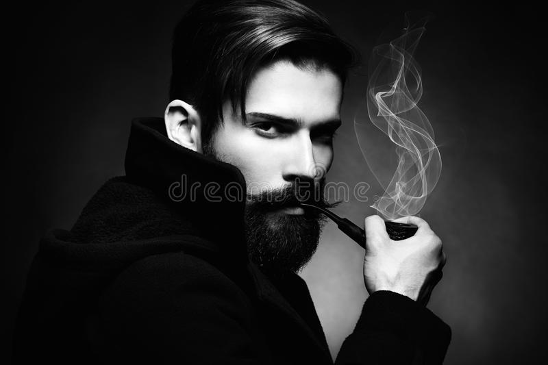 Artistic dark portrait of the young beautiful man. The young man royalty free stock photo