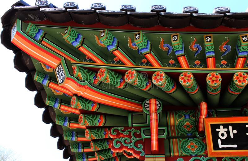 Artistic decorated Korean under roof elements of sanctuary house with traditional ornaments stock photography