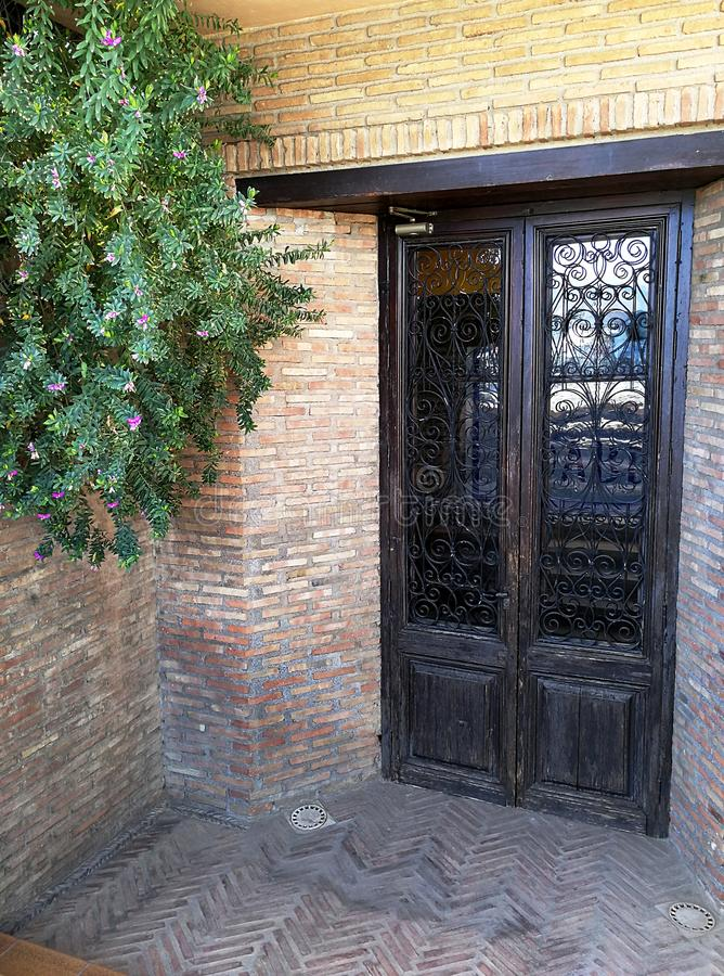 Artistic door with grille and glass. In andalusian patio stock photos