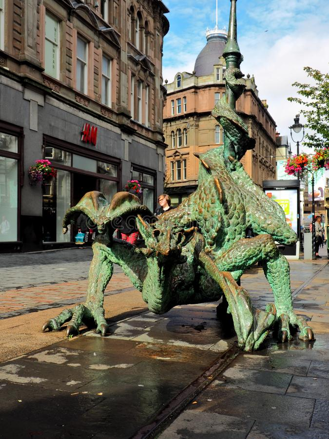 Dundee dragon. An artistic dragon statue in the square in the center of the Scottish city of Dundee royalty free stock images