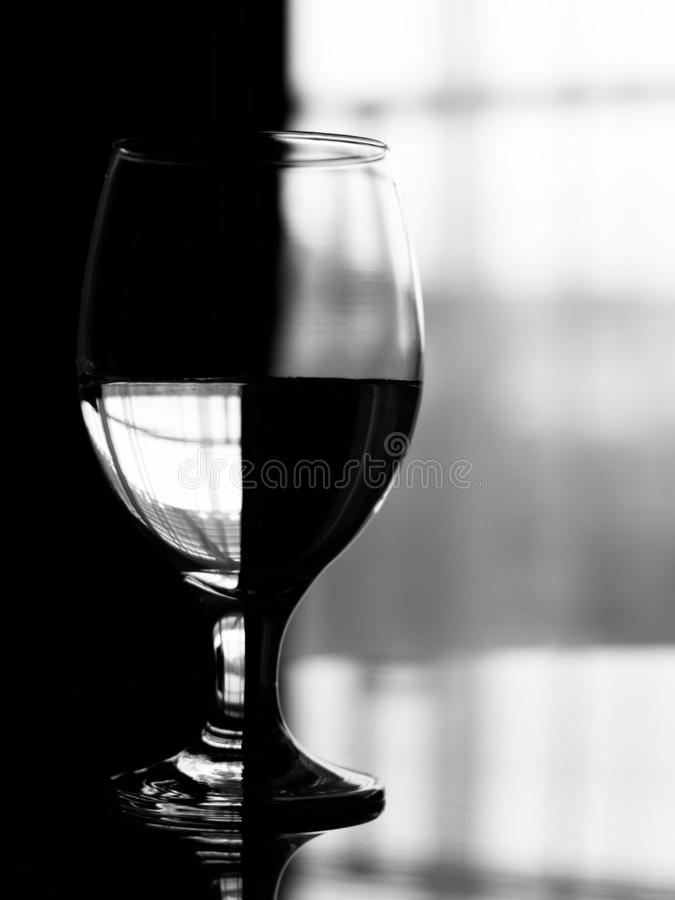 Artistic effect on wine glass filled with water. royalty free stock photos