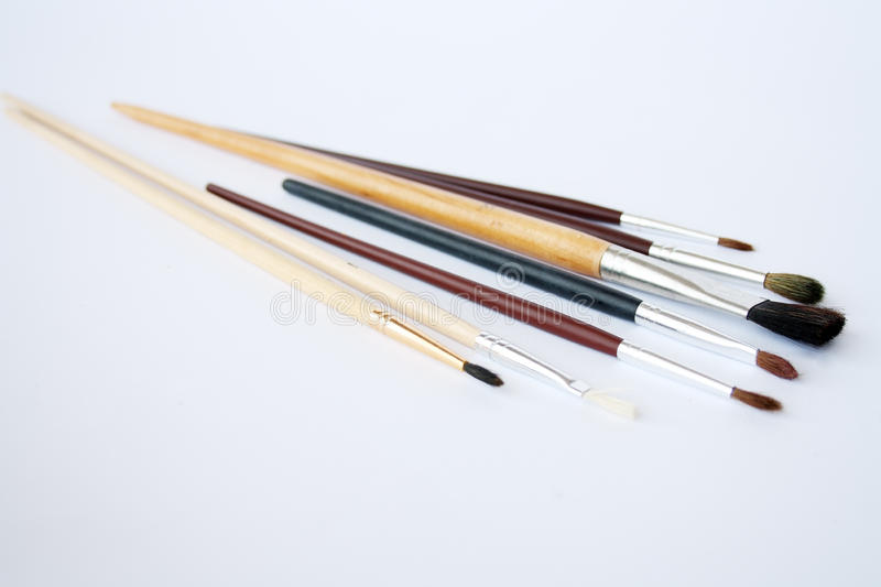 Artistic fine art brushes. Fine art brushes in different sizes. Focus is on the biggers brush royalty free stock image
