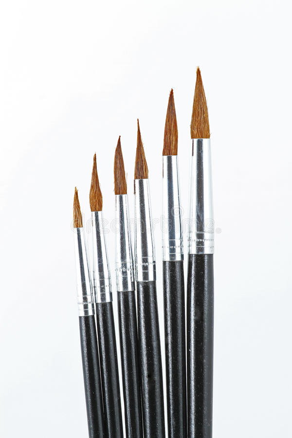 Artistic fine art brushes. Fine art brushes in different sizes on a white background stock photos