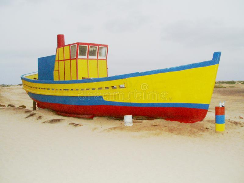 Artistic fishermans boat. A small, artistic grainy picture of a brightly painted fishermans boat in the tropics stock image