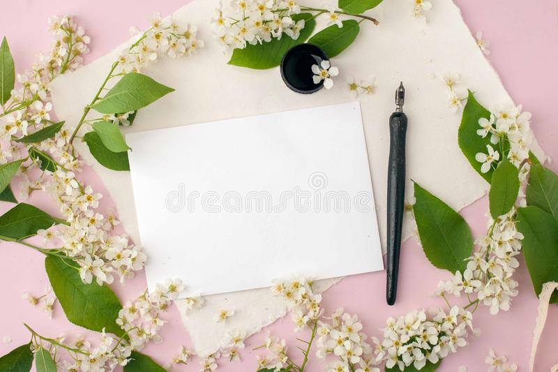 Artistic floral composition, workspace with quote follow your heart written in calligraphy style on white paper. Artist working royalty free stock photos