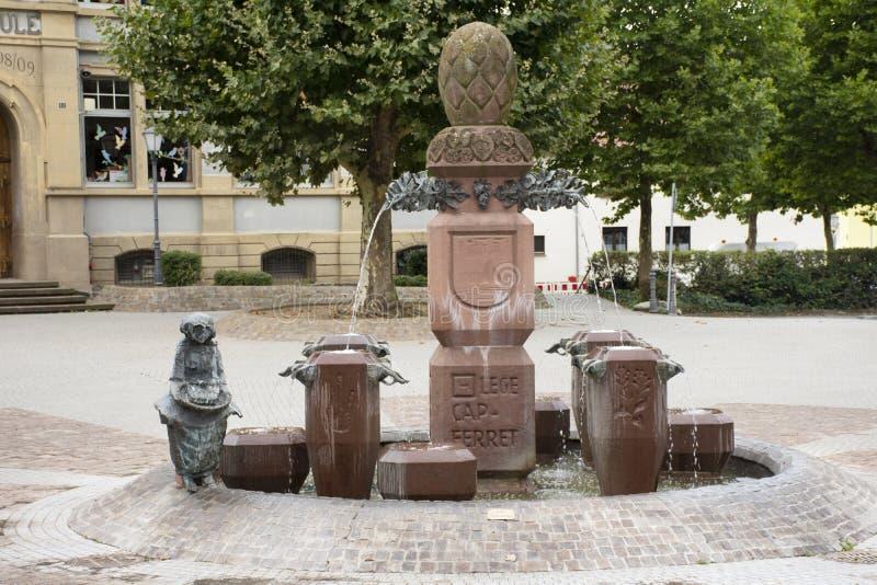 Artistic Gemeinde statue and fountain in public park at Sandhausen village in Heidelberg, Germany stock photos