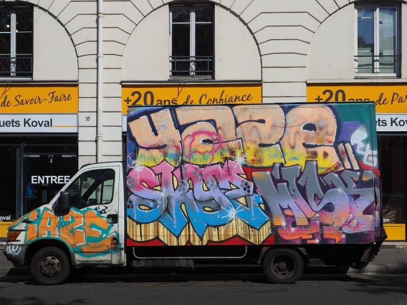 Artistic graffiti covers a van stock image