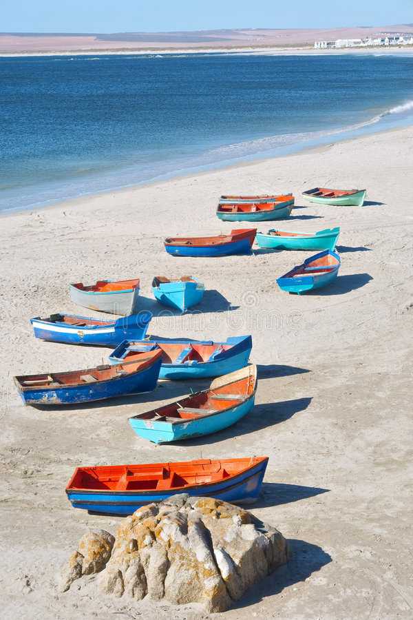 Artistic group of boats on shore stock photo