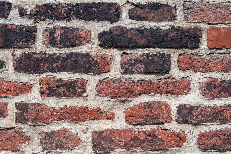 Artistic grunge textured background from an ancient brick wall for a creative design or historical project royalty free stock photo
