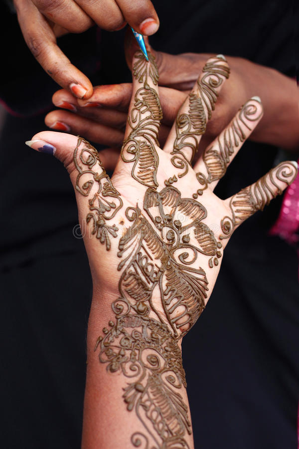 Artistic Henna designing on Hand stock images