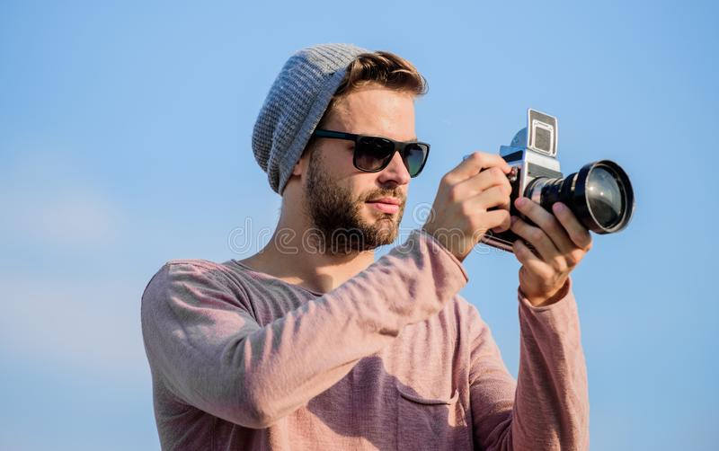 Artistic joy of Capturing the World. sexy man touristic reporter. capture adventure. journalist. photographer in glasses stock photography