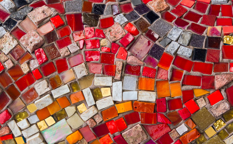 Artistic Mosaic. Colorful pieces of glass and stone pressed into masonry make a decorative and colorful mosaic design stock photography