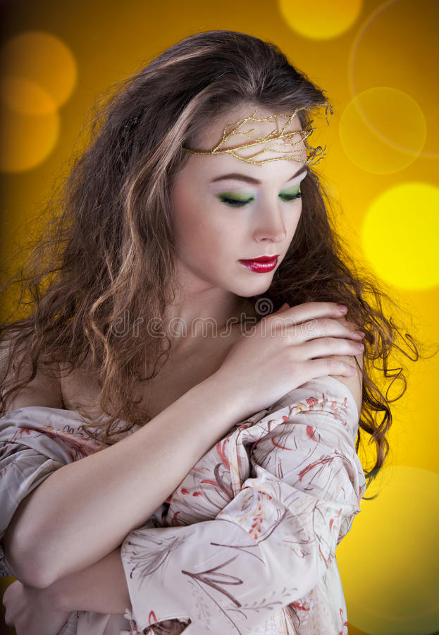 Artistic portrait of glamour girl on abstract background. Studio shot stock photo