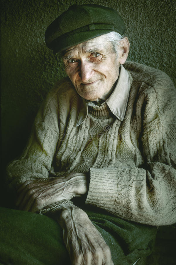 Artistic portrait of old senior man. With wrinkled hands royalty free stock photography