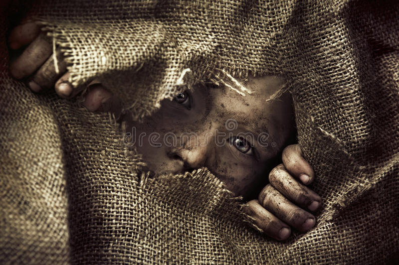 Artistic portrait of a poor little boy. Artistic portrait of a poor little kid stock photography