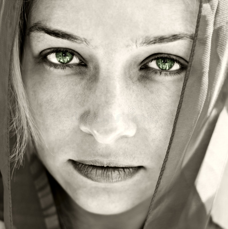 Artistic portrait of woman with beautiful eyes. Artistic portrait of mysterious woman with beautiful eyes stock photography