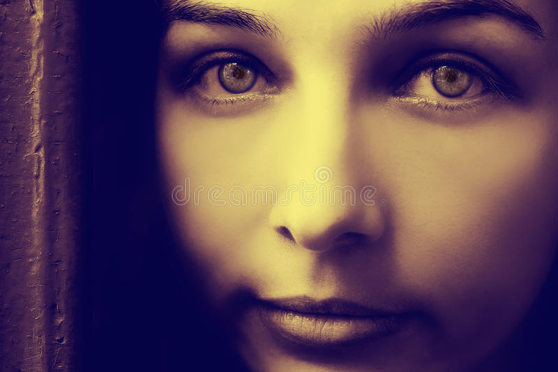Artistic portrait of woman with spooky eyes. Artistic portrait of mysterious young woman with spooky eyes royalty free stock images