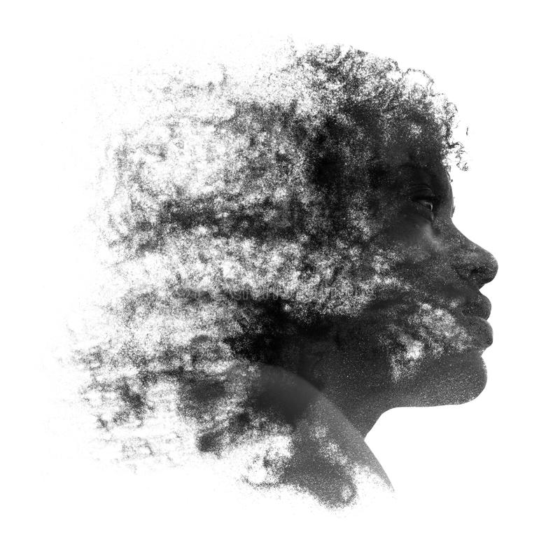 Artistic portrait of a young African woman. With fine grains of sand caught in her curly frizzy hair and coating the skin of her face, black and white profile royalty free stock photos
