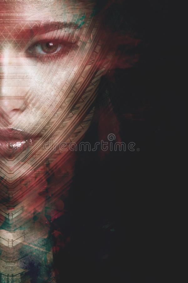 Artistic portrait of young woman double exposure half face closeup stock photography