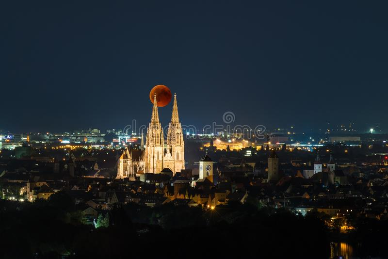 Artistic representation - Blood Moon over the Cathedral in Regensburg - July 2018, Germany stock photo