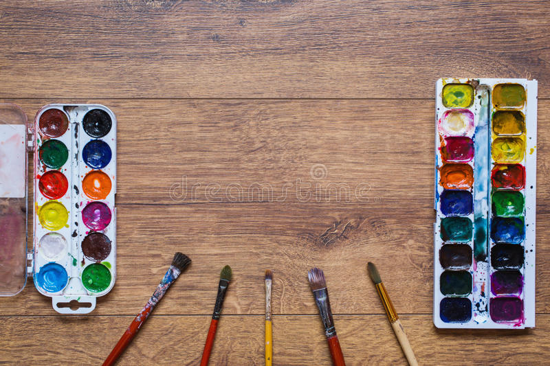 Artistic squirrel brush and water paints. Drawing tools for pupils, students, artists. stock photo
