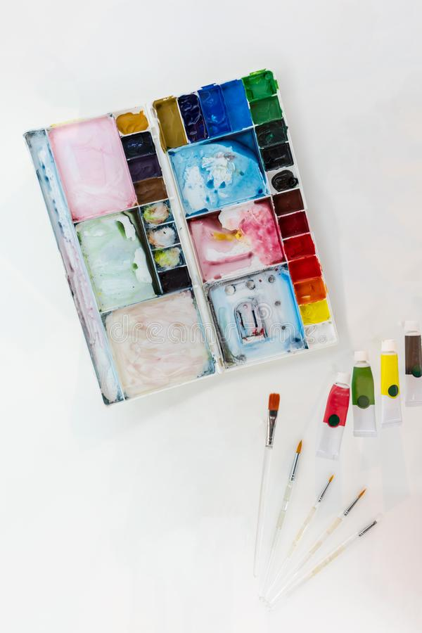 Artistic squirrel brushes, tubes of oil paints and watercolors on white background stock photography