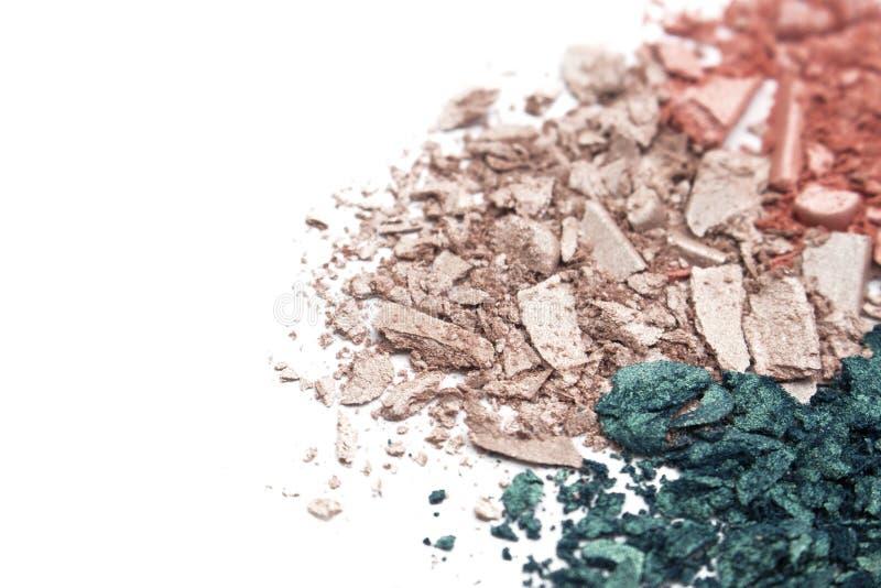 Colorful powder eye shadow texture on white background stock photos