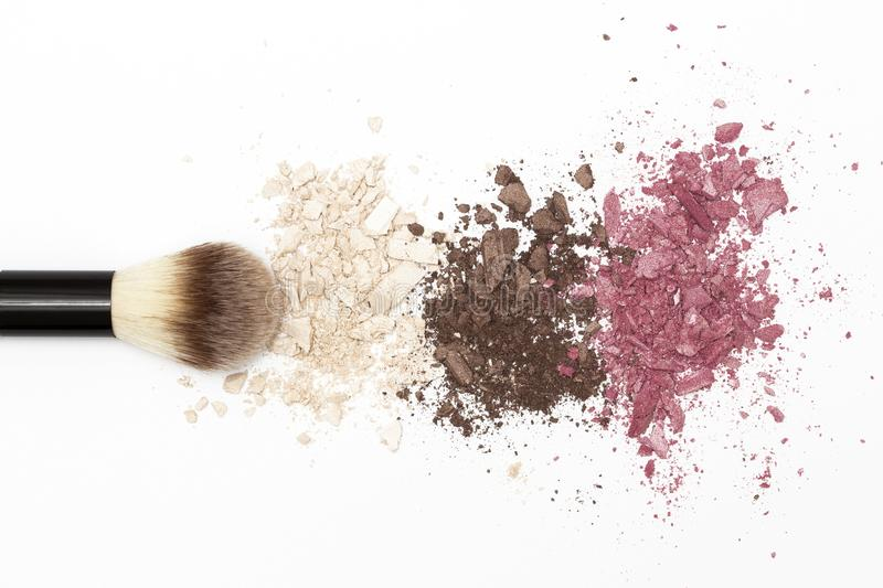 Eye shadow texture and cosmetic brush on white background stock photos