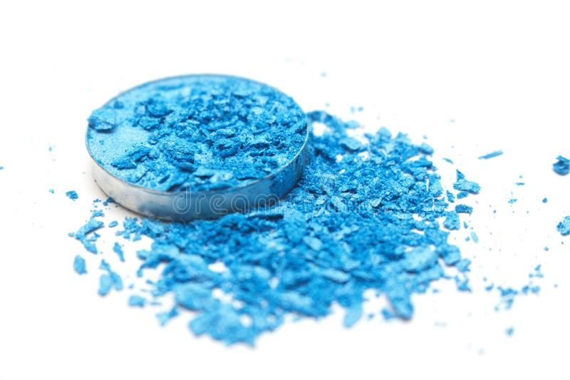 Artistic style crashed eyeshadow in bright blue on white background royalty free stock images