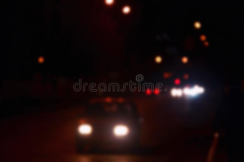 Artistic style - Defocused urban abstract texture, blurred background with bokeh of city lights from car on street at night, vint. Age or retro color tone stock images