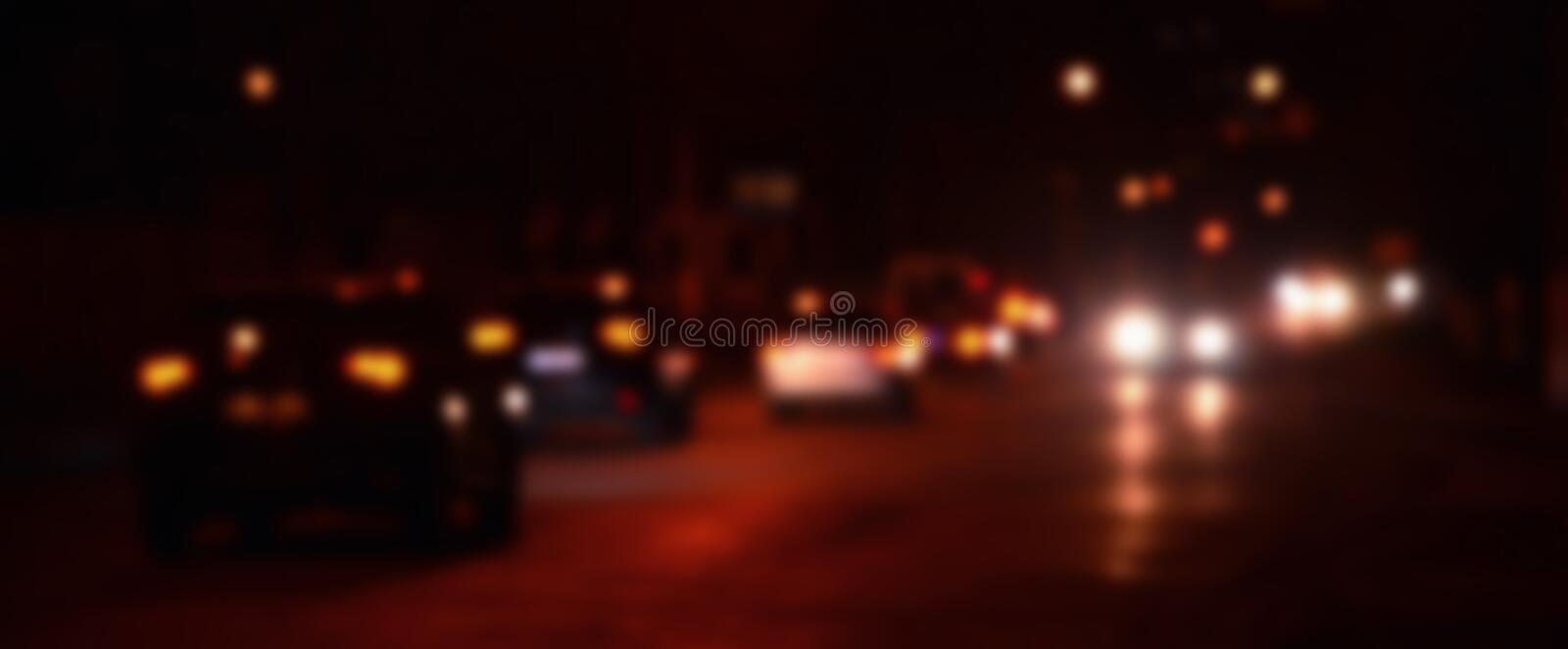 Artistic style - Defocused urban abstract texture, blurred background with bokeh of city lights from car on street at night, vint. Age or retro color tone royalty free stock photos