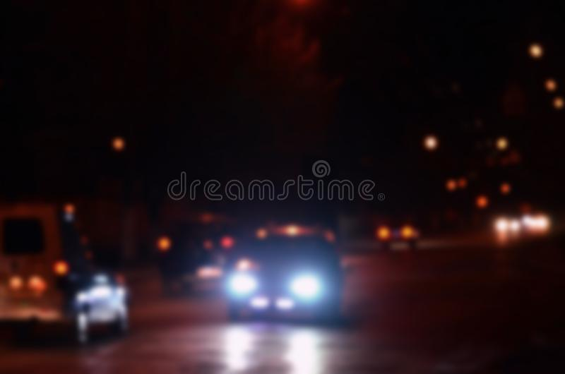 Artistic style - Defocused urban abstract texture, blurred background with bokeh of city lights from car on street at night, vint. Age or retro color tone royalty free stock images