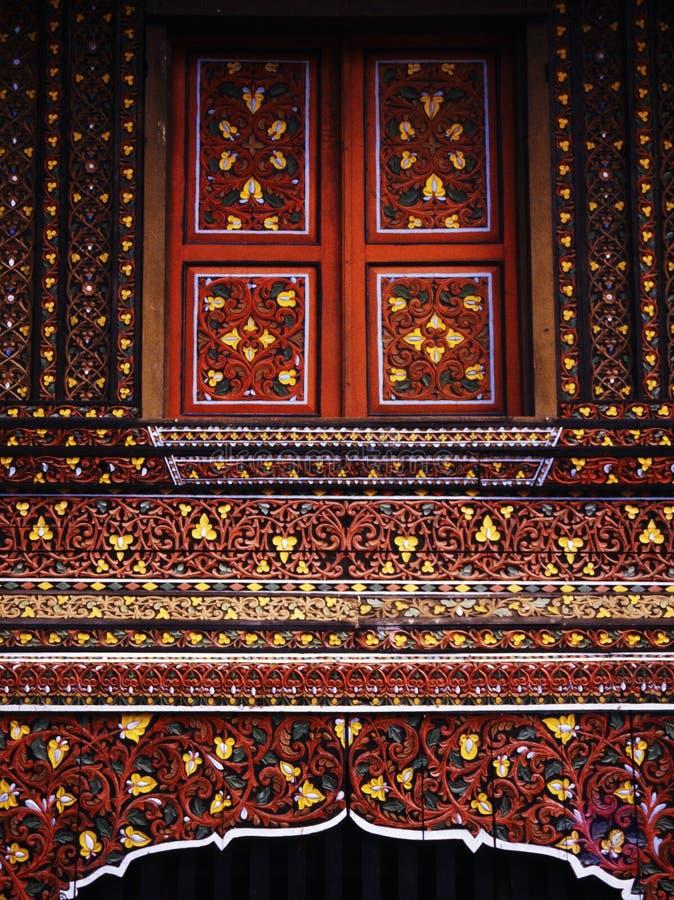 Artistic Sumatran window. Detailed ornament of a traditional Sumatran house. (Slide film FUJI RH stock photos