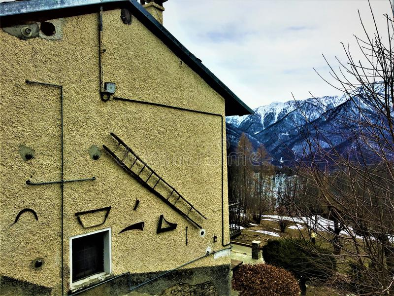 Artistic wall, tools, winter and mountains stock images