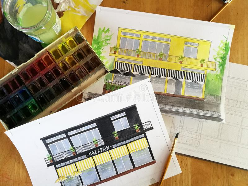 Watercolor sketches of house on table stock image