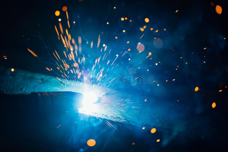 Artistic welding sparks light, industrial background. Artistic welding sparks blue light, industrial background stock photography