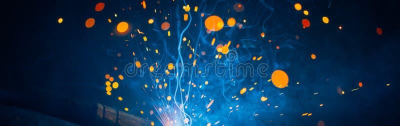 Artistic welding sparks light, industrial background. Artistic welding sparks light, blue and orange colors, industrial background stock photography