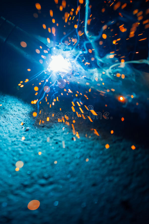 Artistic welding sparks light, industrial background. With copy-space stock images