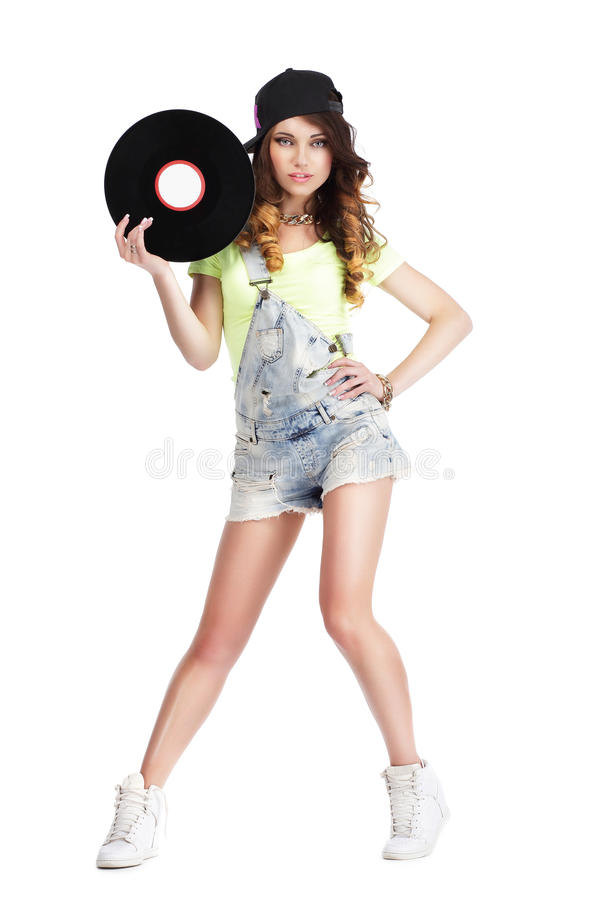 Artistic Woman in Jeans showing Retro Vinyl Record. Cute Woman in Jeans showing Retro Vinyl Record stock image