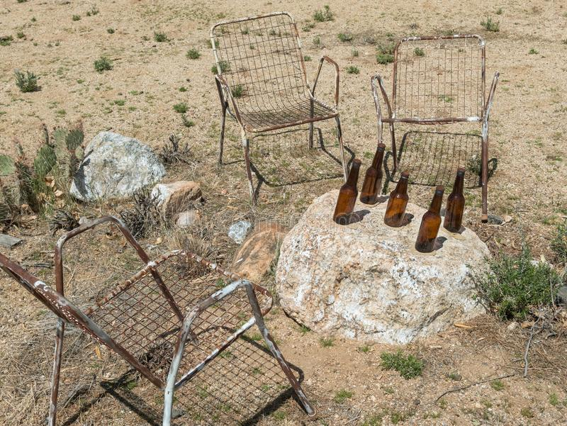 Yard art, chairs and bottles royalty free stock photos
